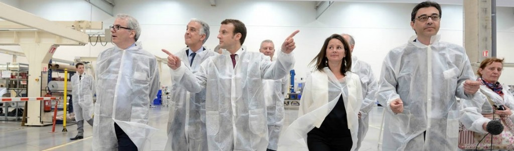 French Economy and Industry minister Emmanuel Macron (C) visits the Daher plant on May 18, 2015 in Saint-Aignan-Grandlieu near Nantes, western France. The Daher Company manufactures aircraft structures for Airbus, Dassault or ATR and employs 8500 people. AFP PHOTO / JEAN-SEBASTIEN EVRARD