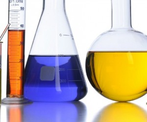 Laboratory glassware with color fluids over white background